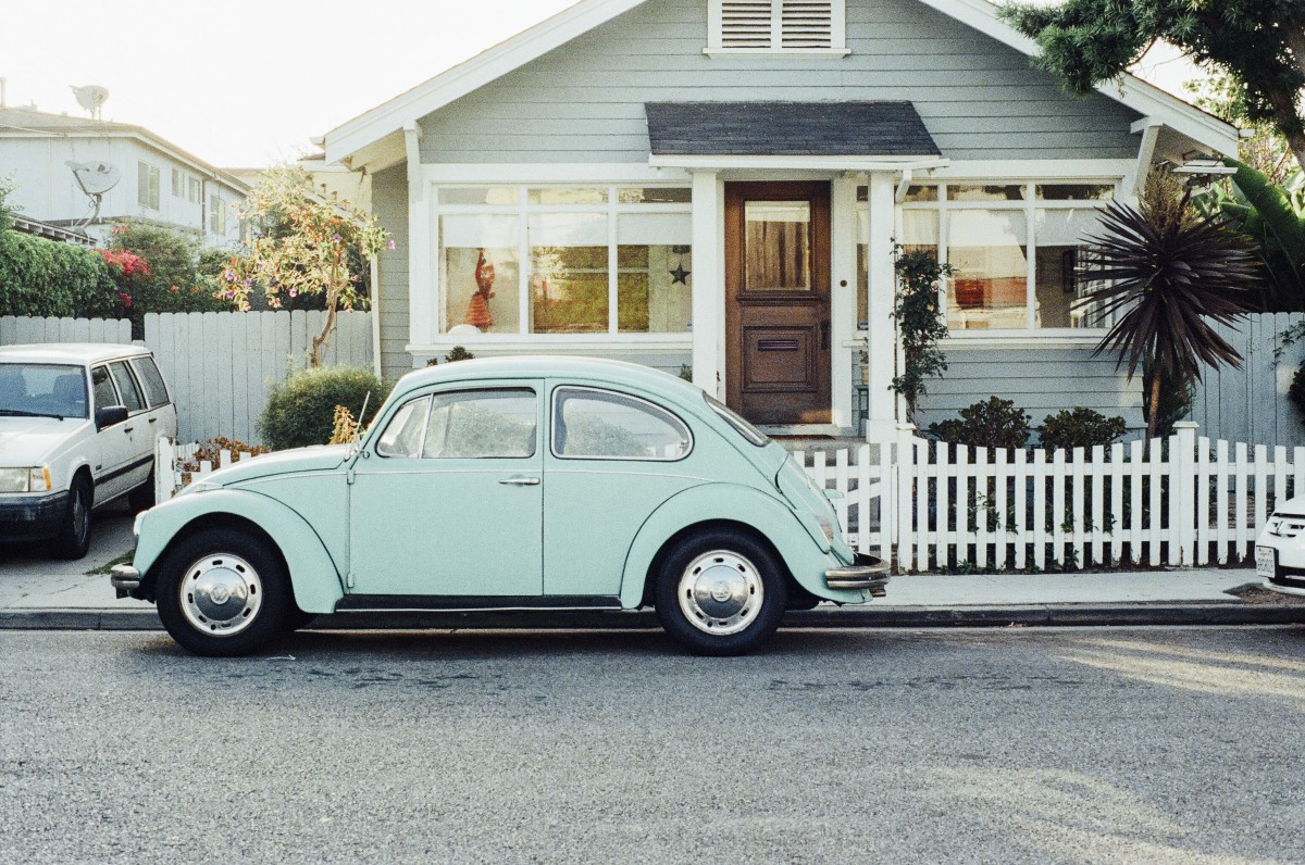 old VW bug in front of house