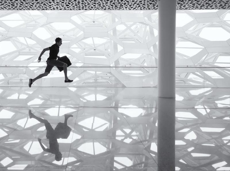 man running in modern building