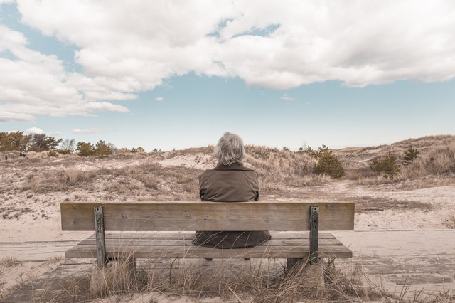 old woman sitting on bench