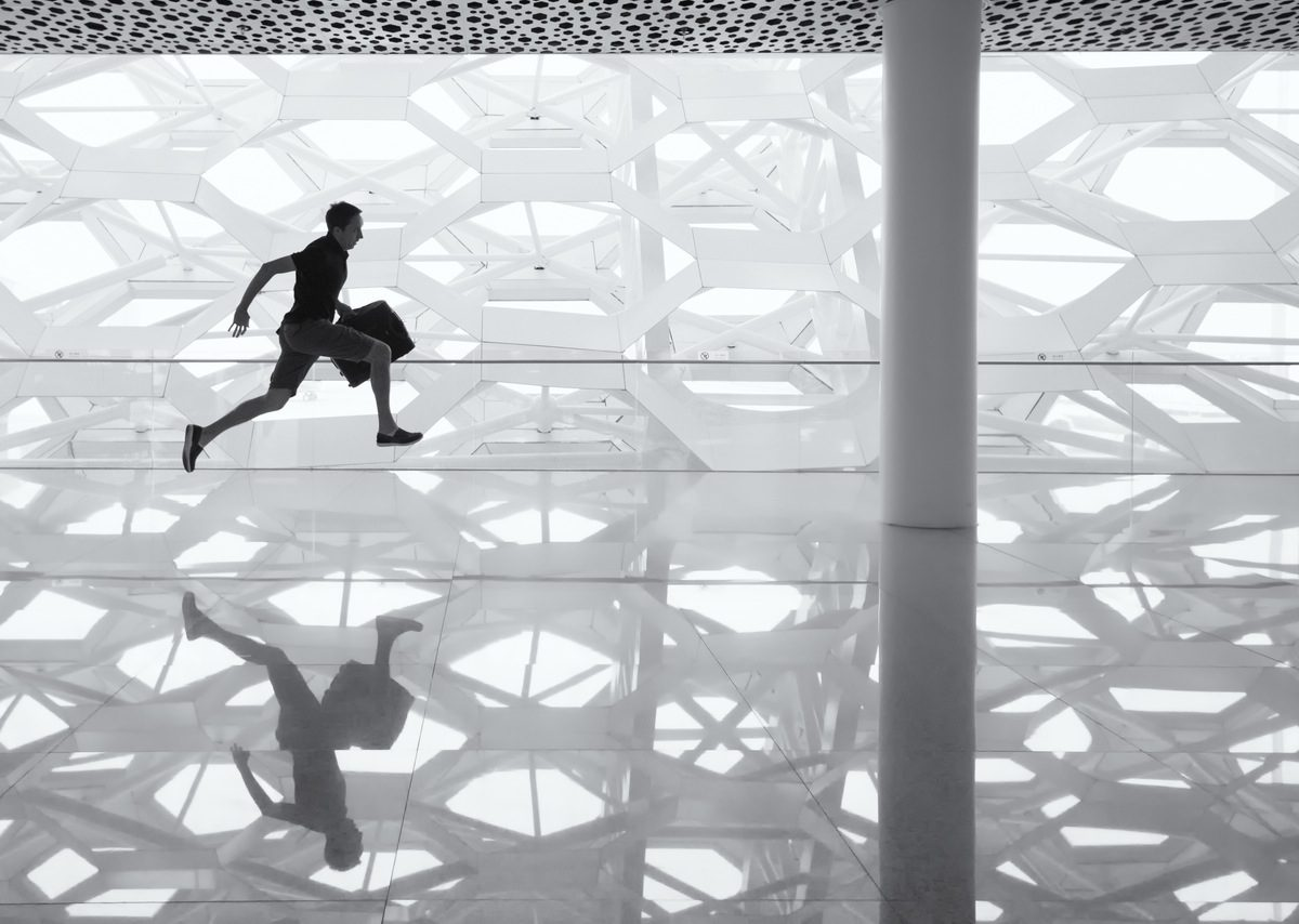 man running through modern building