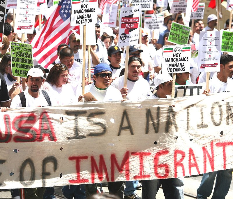 march w/ banner: USA is a nation of immigrants