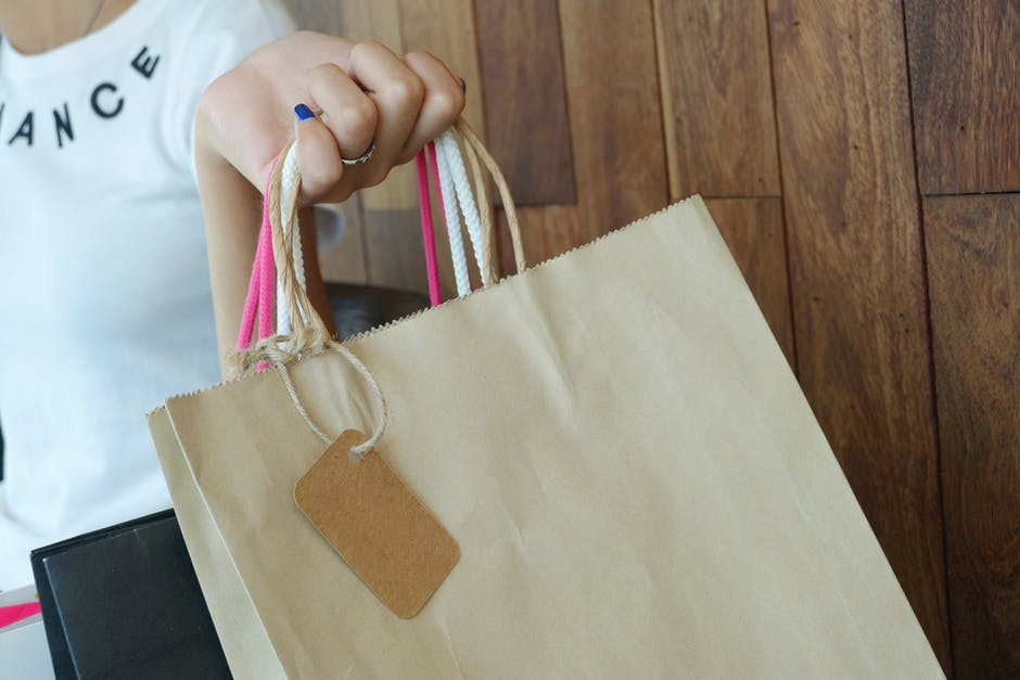 woman holding multiple shopping bags