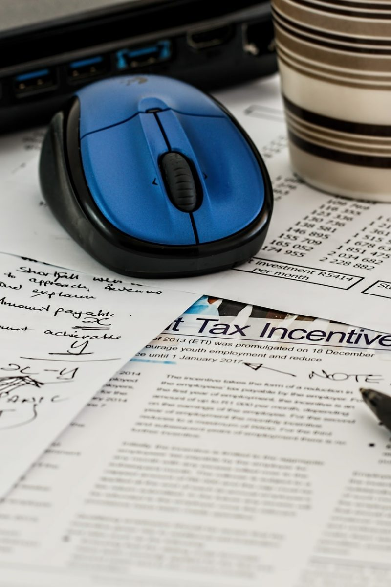 tax papers, computer mouse, pen