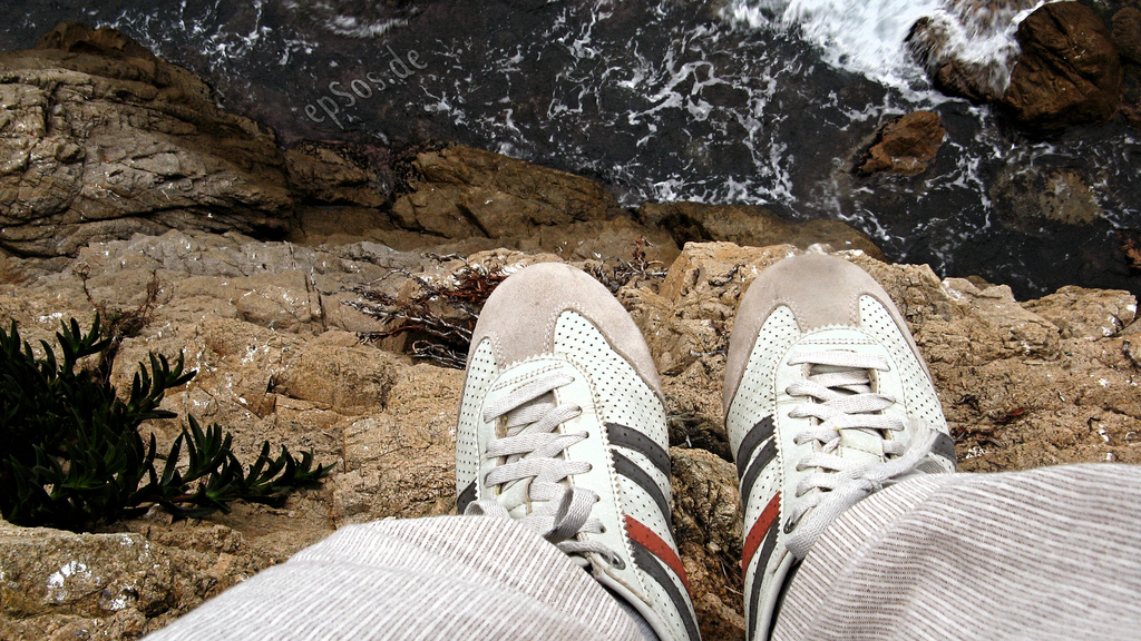 shoes at edge of cliff