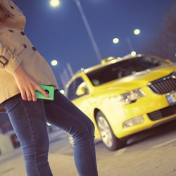 woman standing before taxi