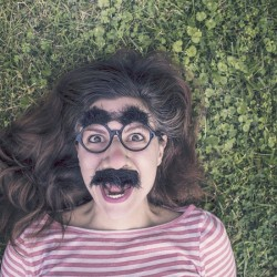 woman with mustache glasses
