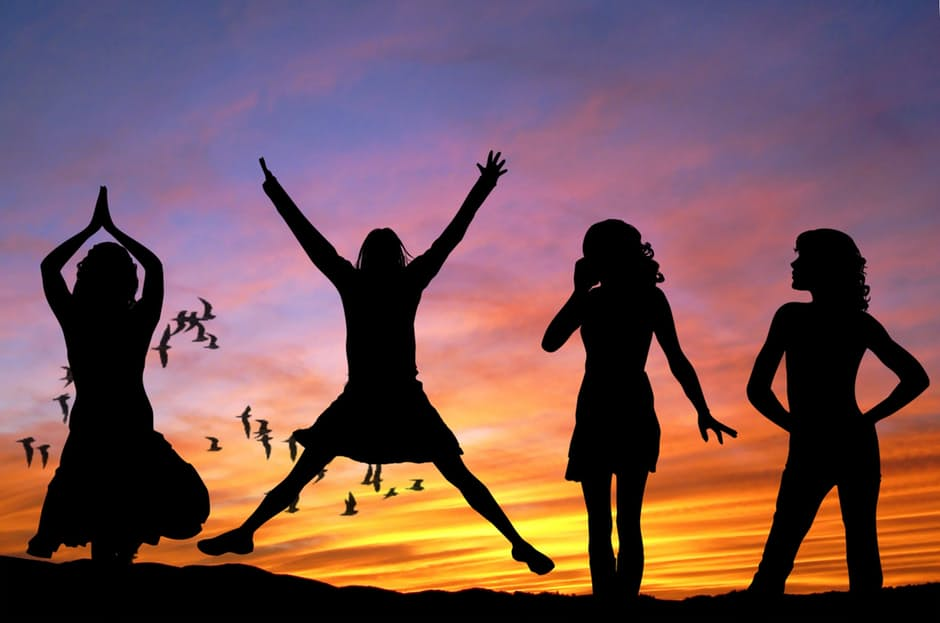 silhouette of girls dancing against sunset